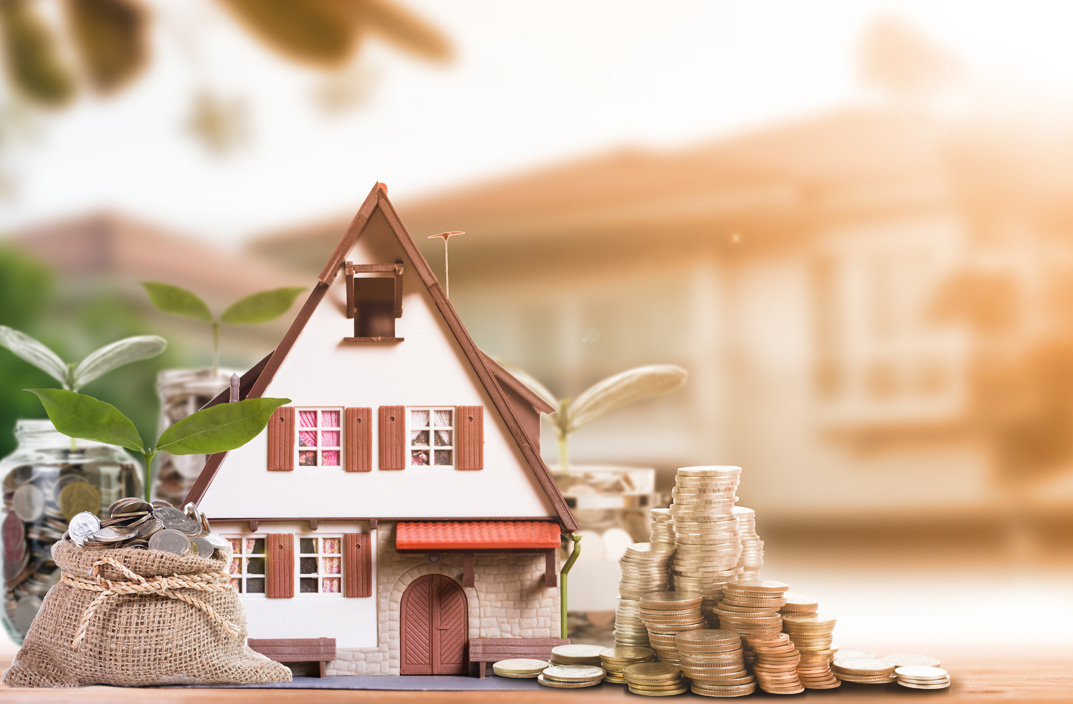 Model house with piles of coins outside : Invoice factoring & Asset Finance from Go-Factor