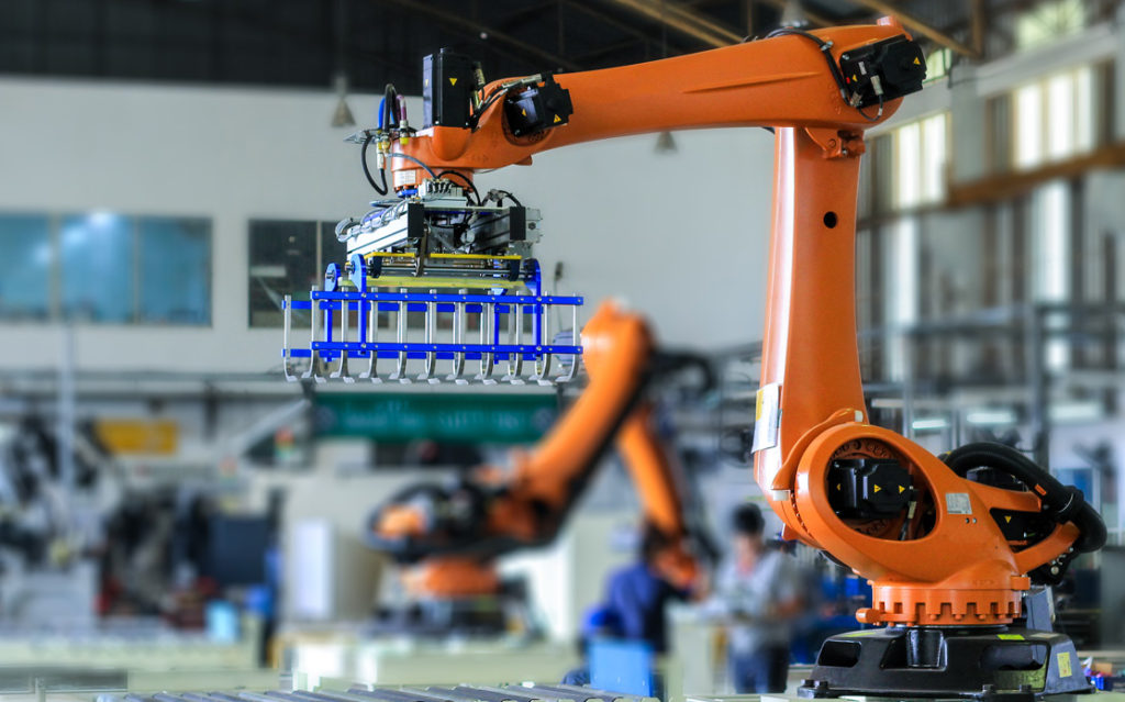 Orange Robot arm in factory : Invoice factoring & Asset Finance from Go-Factor